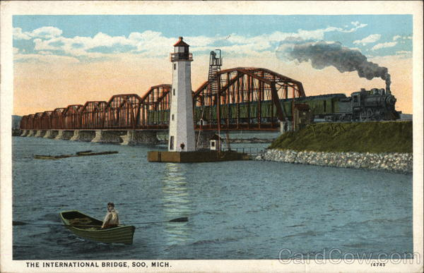 The International Bridge, with Lighthouse Tender in Foreground Soo Michigan