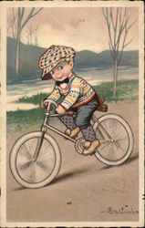 Boy Wears a Cap and Rides Bicycle Near a Stream