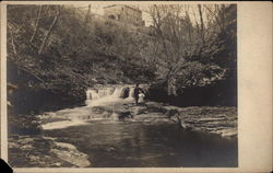 Couple Standing by River and Waterfall Postcard