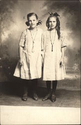 Two Girls in Matching Dresses
