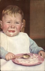 Crying baby with plate of food
