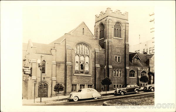 Cars Parked In Front of Church Buildings