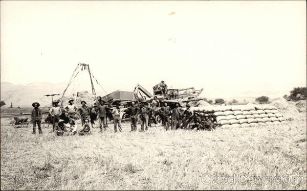Farmers and Machinery in Field Men