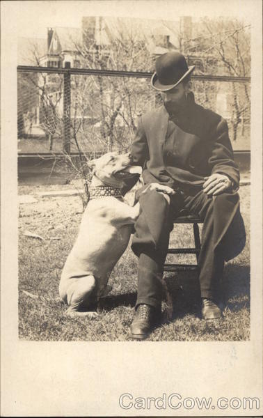 Man in Hat with Pit Bull Dogs