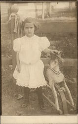 Little Girl with Rocking Horse
