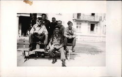 Soldiers Sitting on Park Bench