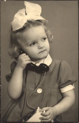 Young Girl on Toy Telephone