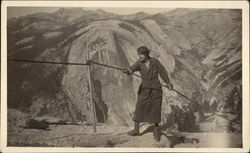 Woman with Ropes on Mountain