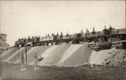 Men Atop Railcars