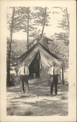Men outside Tent with Finnish & American Flags
