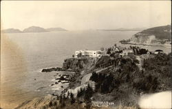 Hotel and Homes on the Bluff Over the Ocean Postcard
