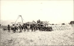 Farmers and Machinery in Field