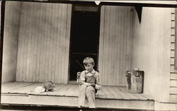 Young Boy on Porch