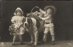 Two Children Posing with St. Bernard