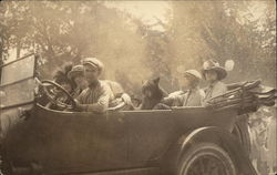 People in Car with Bear