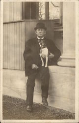 Portrait of Elderly Man in Bowler Hat with Dog