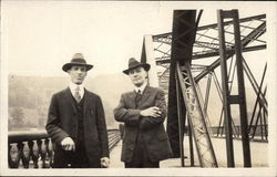 Two Men on Bridge