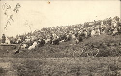 Students sitting on a Hill, Bicycle