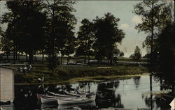 Lakeside scene, with canoes