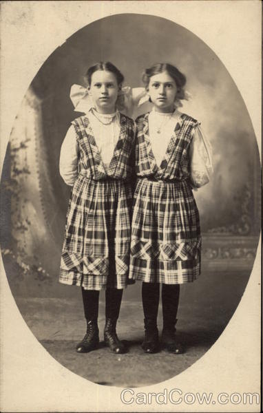 Portrait of Two Girls in Matching Dresses