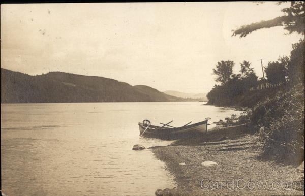 Canoe at edge of water Cooperstown New York
