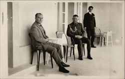 Three Men on Porch