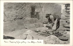Maria - Preparing to fire pottery