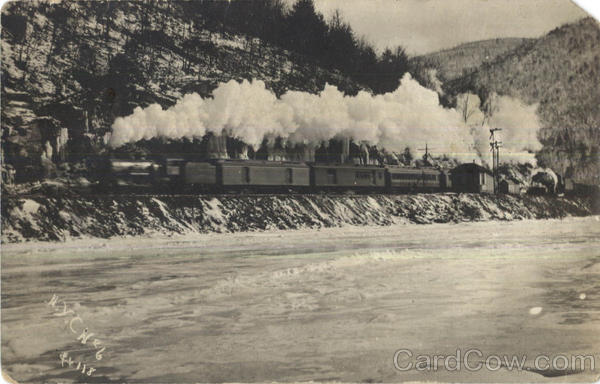 Steam Engine Traveling Along a River in the Mountains
