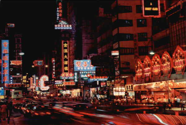 Glows at Night at the Golden Mile of Nathan Road Hong Kong China