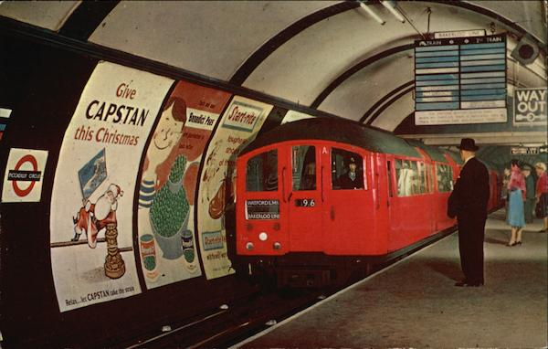 Tube Train entering Piccadilly Circus Station London England