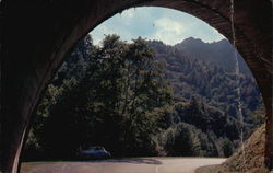 The Chimney Tops seen through archway in tunnel