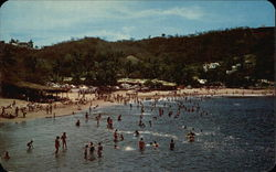 Bathers Swimming at La Audiencia Beach