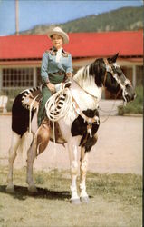 Cowgirl on Pinto Horse