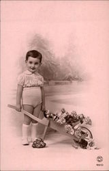 Little Boy with Cart of Flowers