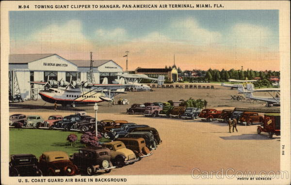 Towing Giant Clipper to Hangar, Pan-American Air Terminal - US Coast Guard Air Base in Background Miami
