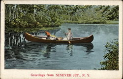 Lady in Canoe on Lake