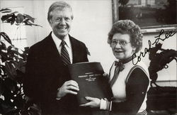Presenting commemorative album to Jimmy Carter