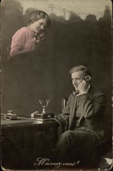 Young Woman and Young Man communicate By Telephone