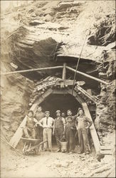 Miners Standing at Mine Entrance