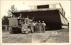 Men With Caterpillar Tractor Pulling Barge