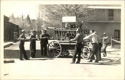 Men on Street with Old Fire Engine