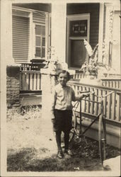 Boy With Bike In Front of Home