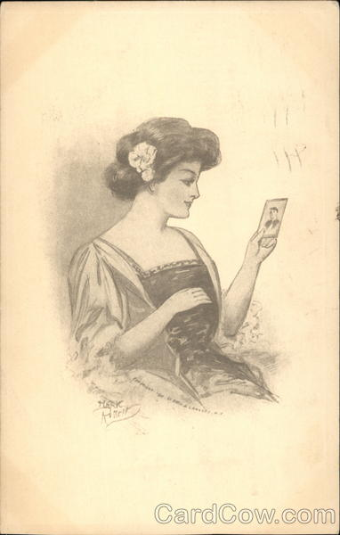 Woman Looking at a Photograph Romance & Love