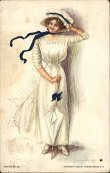 Woman in Long White Dress and Bonnet With Black Bow