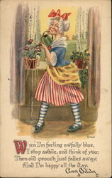 Woman Wearing Stripes and a Bonnet Watering Plants