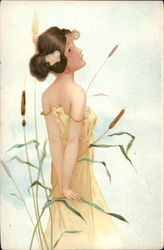 Girl in Long Beige Gown Standing With Cattails