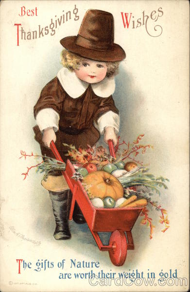 Boy in Pilgrim Outfit Pushes Wheelbarrow With Vegetables