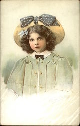 Girl Wearing a Hat With a Blue Bow