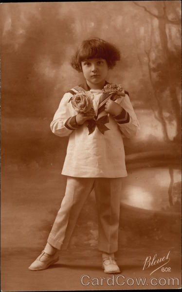 Photograph of Young Child holding Flowers Children