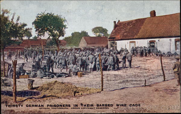 Thirsty German Prisoners in Their Barbed Wire Cage